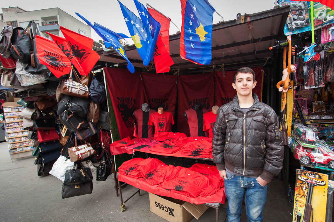 An Albanian young man proudly sells patriotic items in Skopje, Macedonia