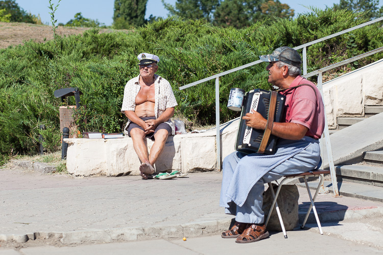 Locals trying to earn a living at an outdoor market in Tiraspol