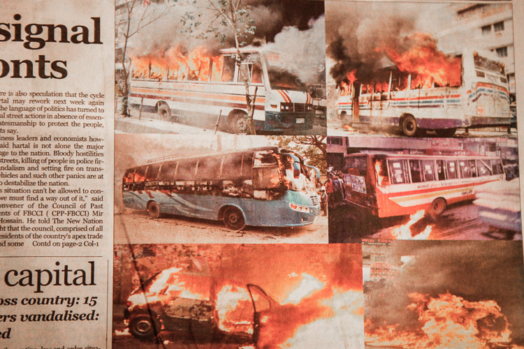 A newspaper in Dhaka reporting about the buses that were attacked that morning