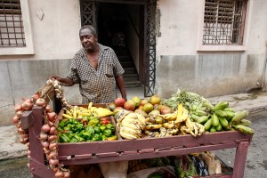 A man selling fruits and vegetables in central Havana