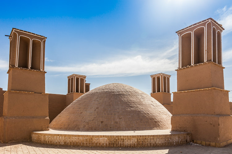A water reservoir with 4 badgirs (cooling towers / windcatcher). With an extremely hot climate, this is the way how Iranians for centuries have been using the wind as a natural air-conditioning.