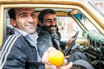 A man offers me to have some of his oranges