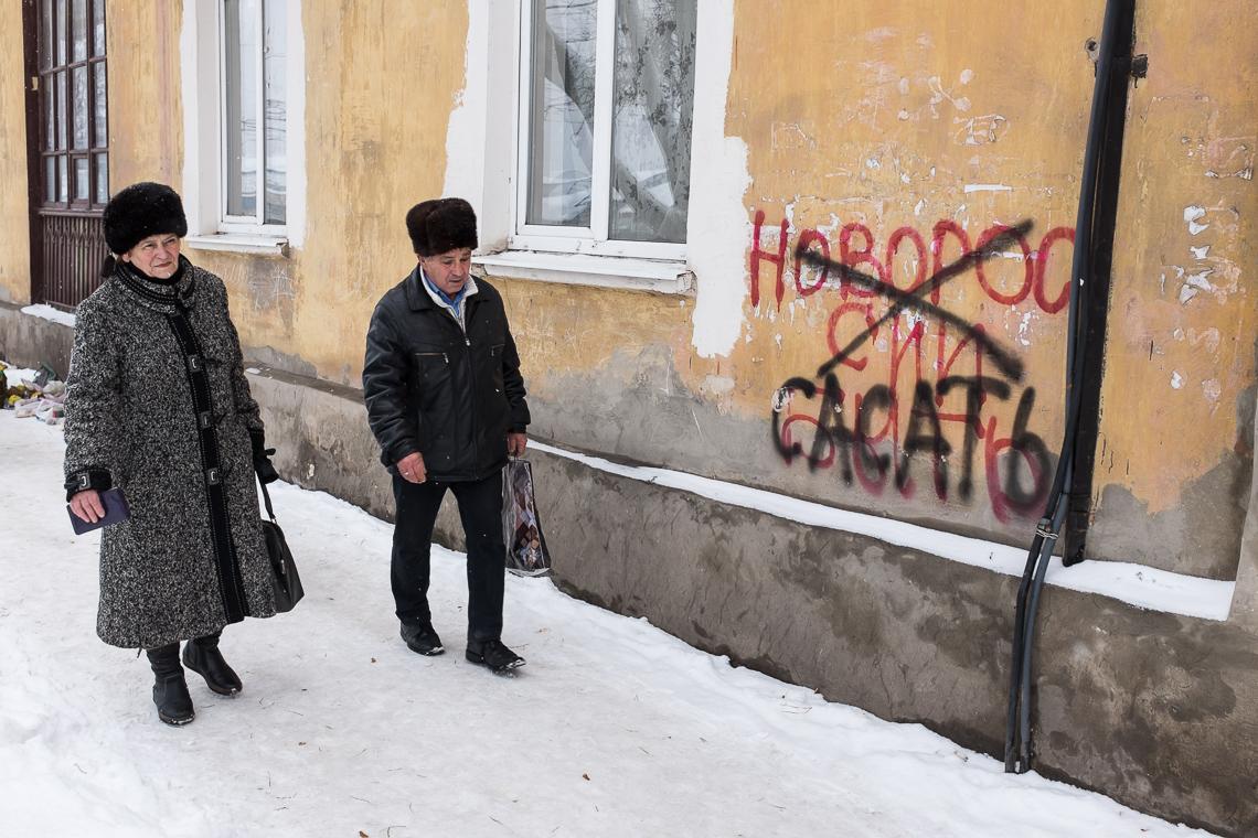 Red graffiti: 'Novorossia to be' - in black: 'sucks'