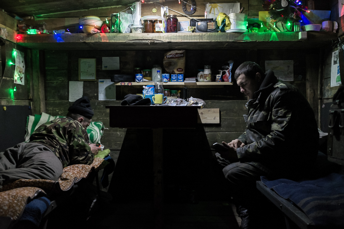 Soldiers are relaxing inside their barrack at a checkpoint
