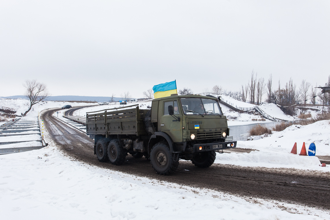 An army truck passes a temporary bridge near Sloviansk
