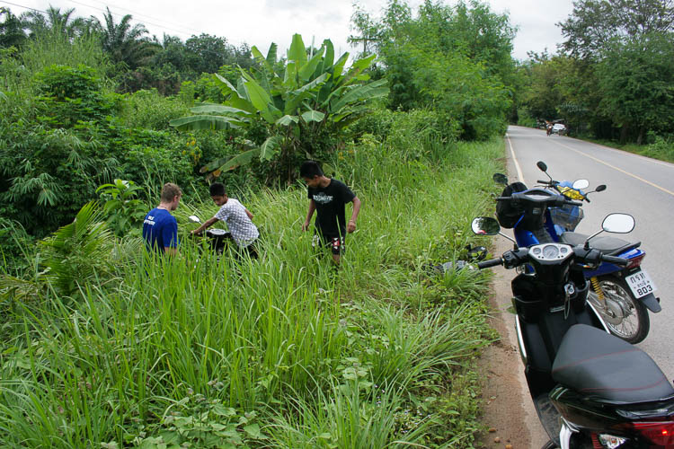 The moment a fellow traveller drove his scooter down a bush in Krabi (Thailand) and almost destroyed it. Locals went for the rescue while I was taking pictures (everything was okay though)