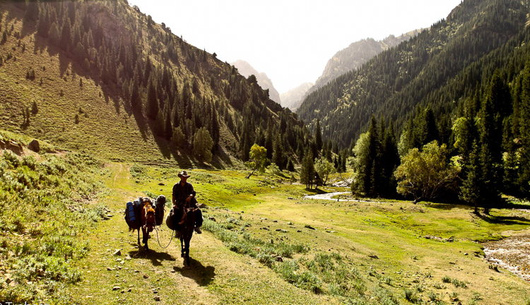 Sebastian and brother Mikael taking their horses through the hills of Kyrgyzstan