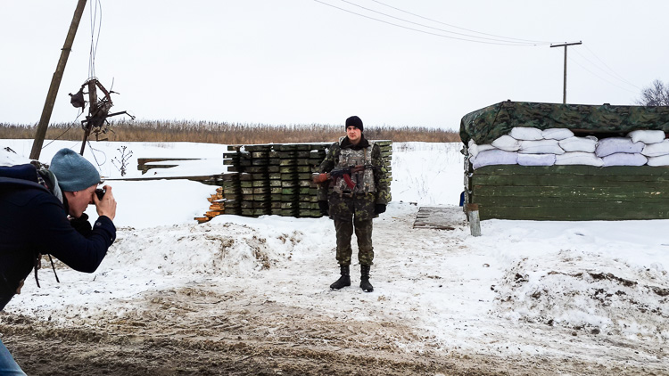 Photographing a soldier at a checkpoint near the former separatist stronghold Sloviansk, Ukraine (photo: Andrew)