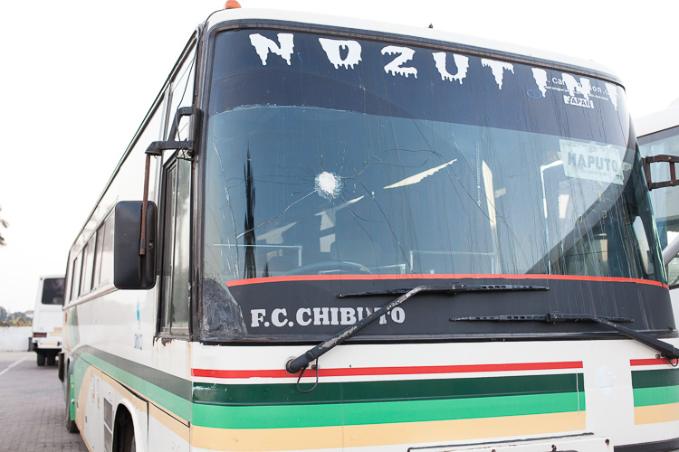 A bus parked at Junta bus station in Maputo. A bullet was aimed right at the driver.