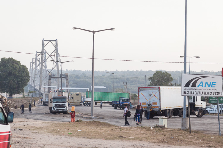7:00 AM, trucks are starting to make their way across the bridge before lining up in a column to traverse the Save-Muxungue road
