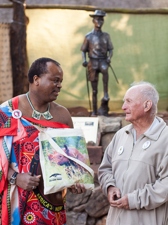 Ted Reilly and Mswati III just unveiled the statue of a ranger behind them