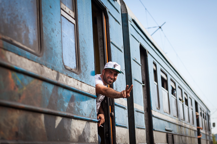 A young man smiles as he is on his way to Tabanovce