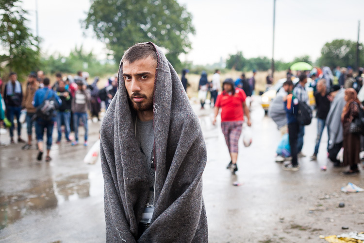 While it's pouring down, refugees are getting on buses to bring them from Gevgelija to Tabanovce. On September 10th, the railway employees were on strike after having not been paid for the last 2-3 months.