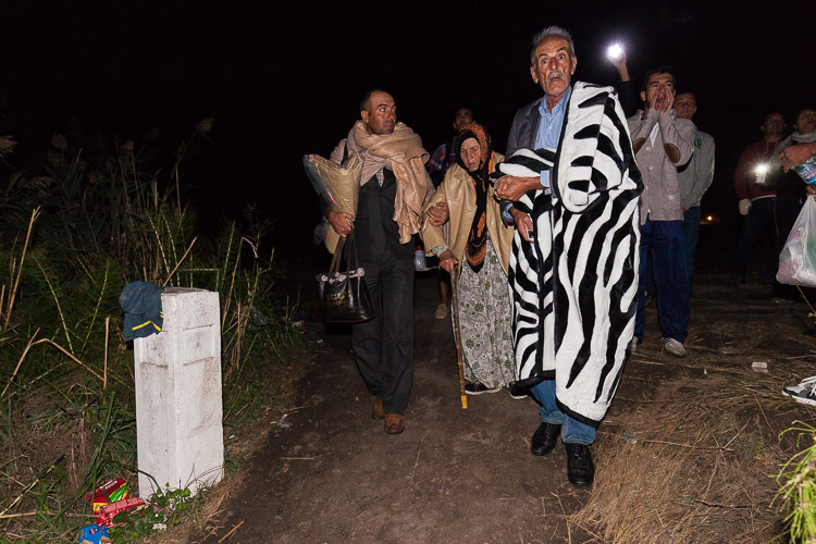 The small white pole marks the official border of Macedonia and Serbia. Volunteers guide people across in the dark. From here, refugees need to walk for 2 kilometers before they hit a Serbian police checkpoint.