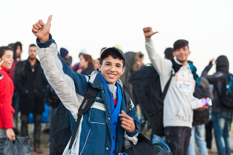 Spirits are up as refugees are crossing into Serbia on an early morning