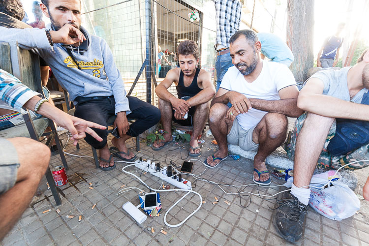 People are charging their phones. One of the main reasons why people are now travelling towards the EU is that the information on Facebook has improved a lot. There are many Facebook pages in Arabic with information on how to contact smugglers, telephone numbers, routes, time tables boats, etc.