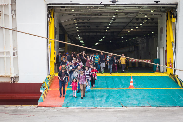The first refugees disembark from El Venizelos and put their feet on the Greek mainland for the first time.