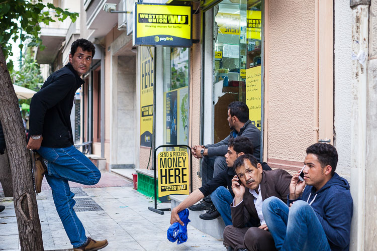 Afghans near Victoria Square (downtown Athens) spend as long as they need to, waiting for money transfers to arrive from the homeland.