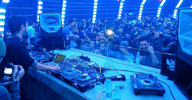 Me standing behind the DJ in a club in Beirut. The city is famous for its party scene, but it comes at a hefty price.
