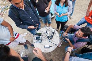 Refugees in Macedonia charging phones