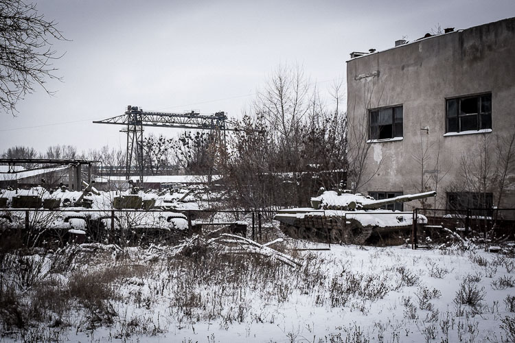 Dozens of old Soviet tanks lay to rust, awaiting a new life.