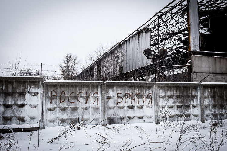 """""""Russia - Bratja"""". Grafitti on the backside of the graveyard claiming the brotherhood between Ukraine and Russia."""