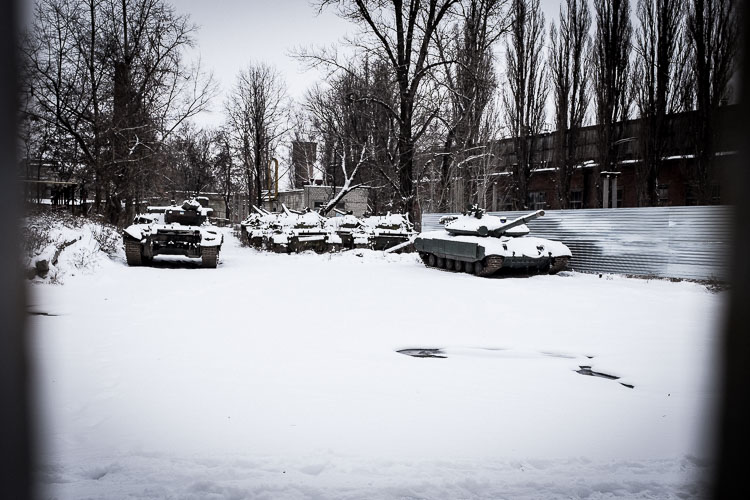 Dozens of old Soviet tanks were rusting away in the snow.