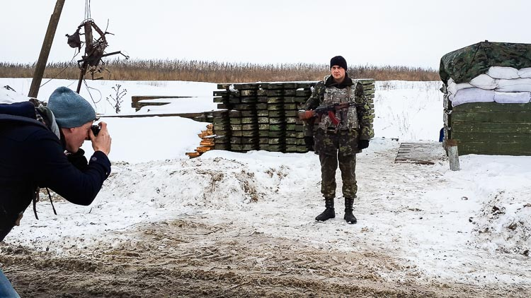 Photographing a soldier at a checkpoint near the former separatist stronghold Sloviansk, Ukraine.